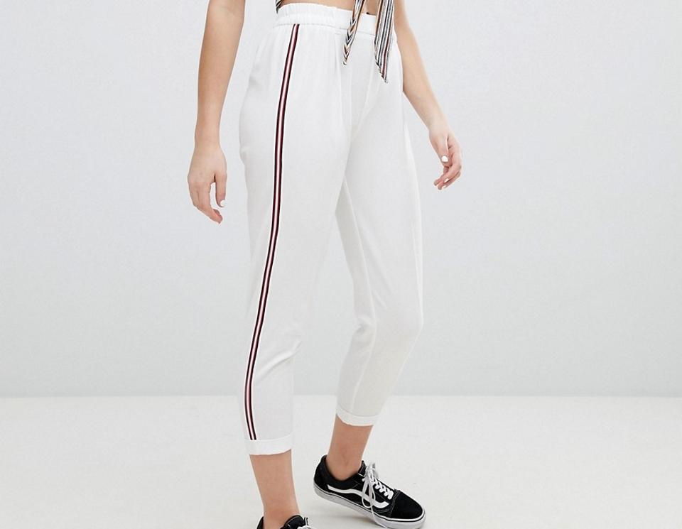 pantaloni bande laterali donna